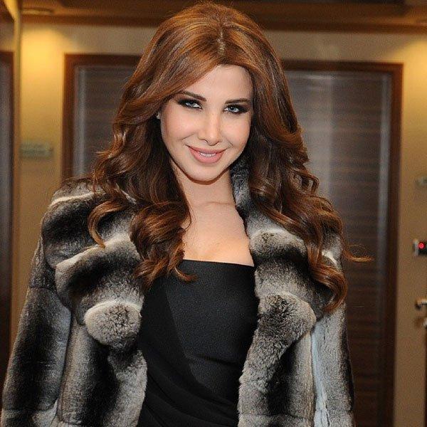 Image result for نانسي عجرم ترتدي الفرو
