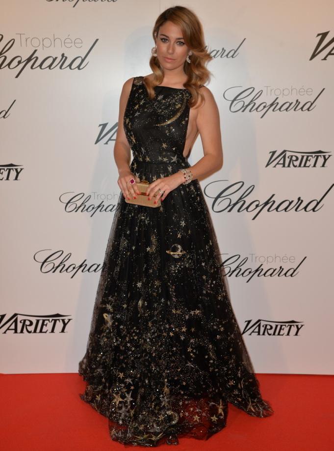 Blanca Suarez carrying a Salvatore Ferragamo gold chain minaudière - 68th Cannes Film Festival