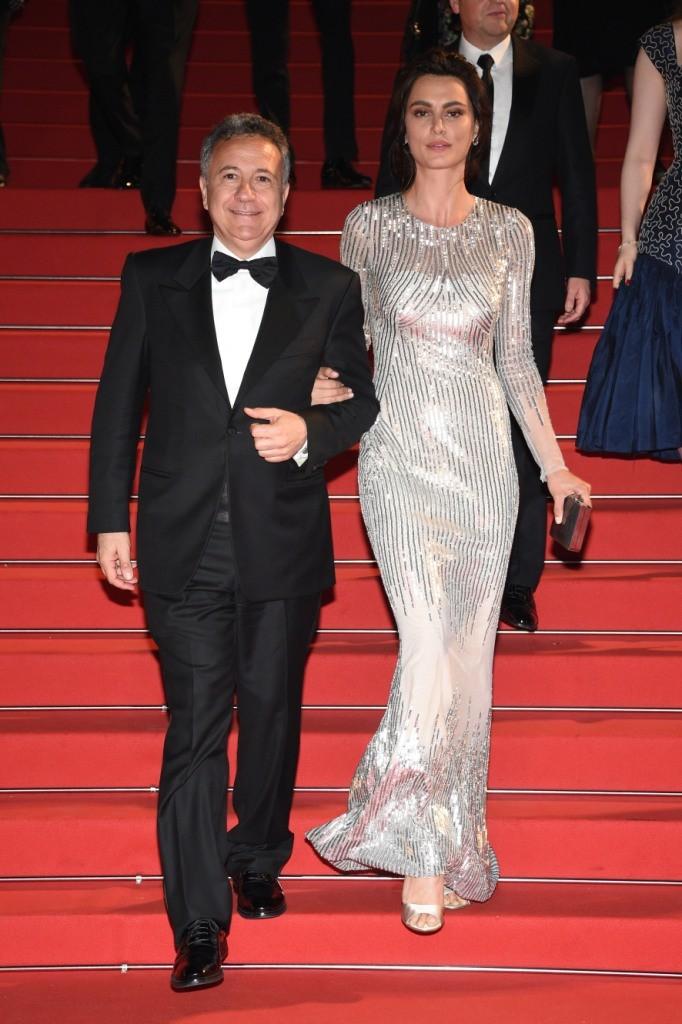 Catrinel Marlon carrying a Salvatore Ferragamo gray and silver minaudière - 68th Cannes Film Festival