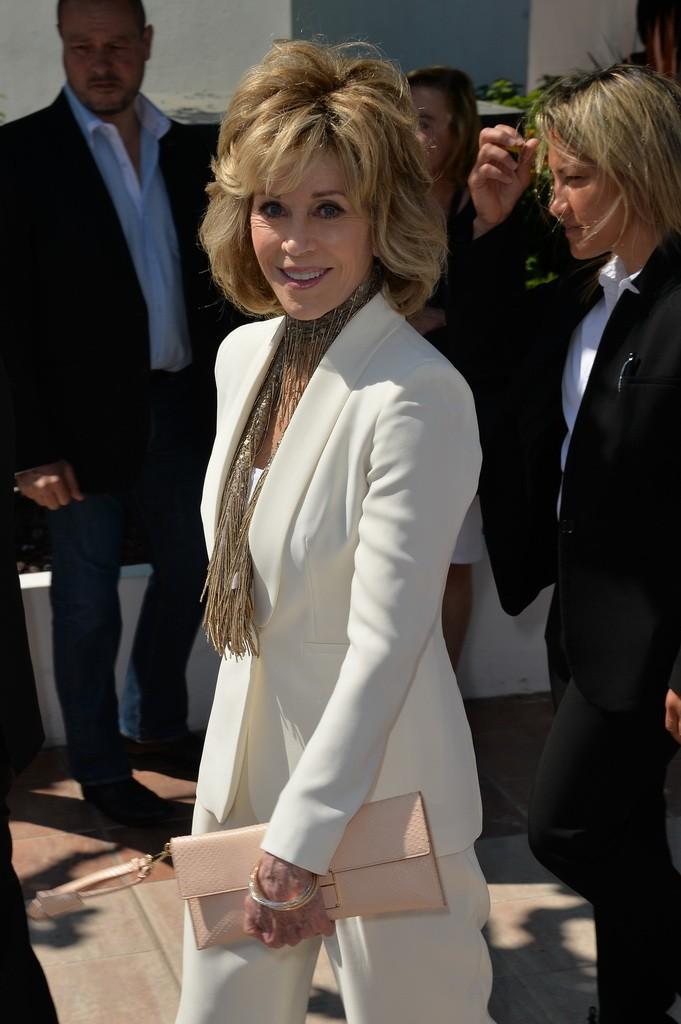 Jane Fonda carrying a Salvatore Ferragamo nude python bag - 68th Cannes Film Festival