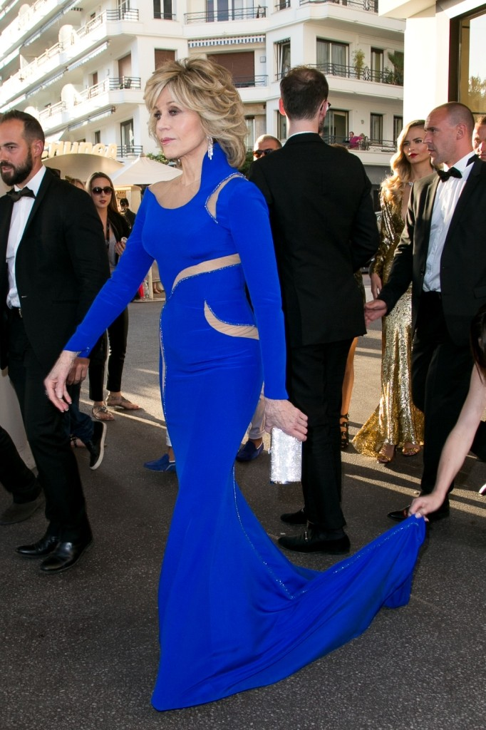 Jane Fonda carrying a Salvatore Ferragamo silver Swarovski clutch - 68th Cannes Film Festival