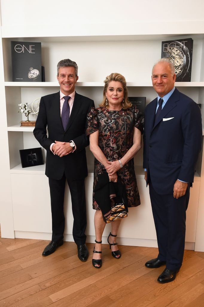 resized_Daniel Riedo, Catherine Deneuve and Charles Finch-'The Art of Behind The Scenes' exhibition. Getty images