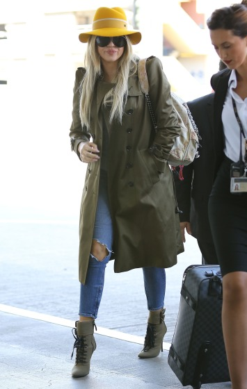 Exclusive... 51752533 Reality star Khloe Kardashian departing on a flight at LAX airport in Los Angeles, California on May 23, 2015. Khloe was in Las Vegas last night to host a party at 1Oak Nightclub. She made it back to Los Angeles in the early morning hours and is already leaving to spend her Memorial Day weekend outside of California FameFlynet, Inc - Beverly Hills, CA, USA - +1 (818) 307-4813