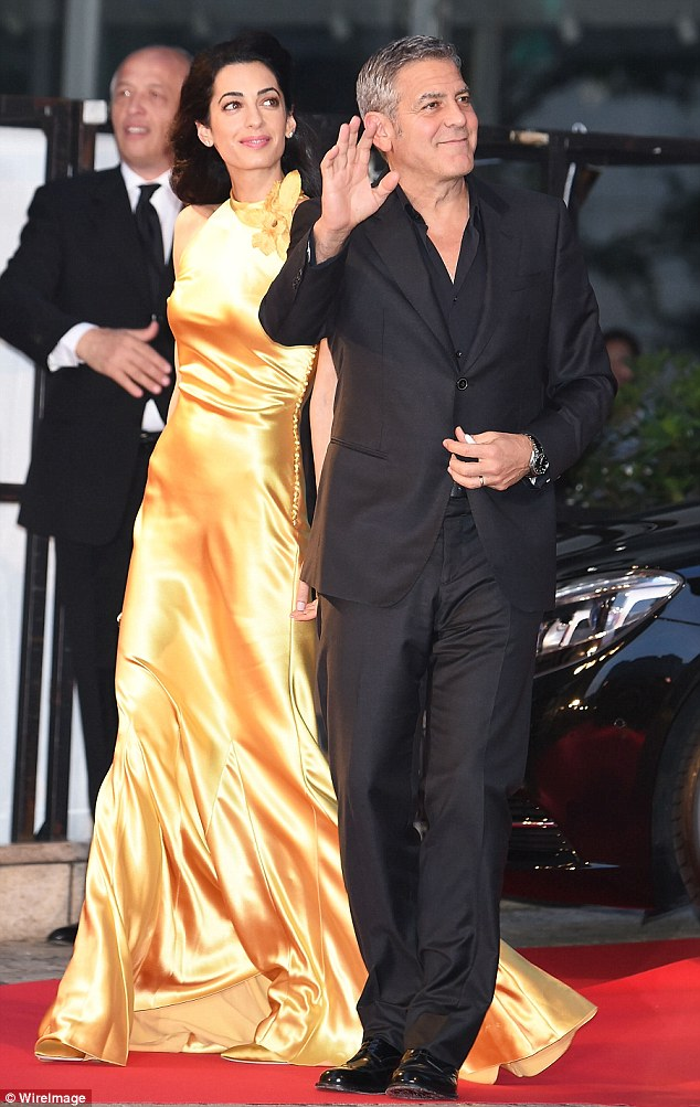 290EC47E00000578-3096100-The_power_couple_George_Clooney_and_his_wife_Amal_were_pictured_-a-1_1432564613470