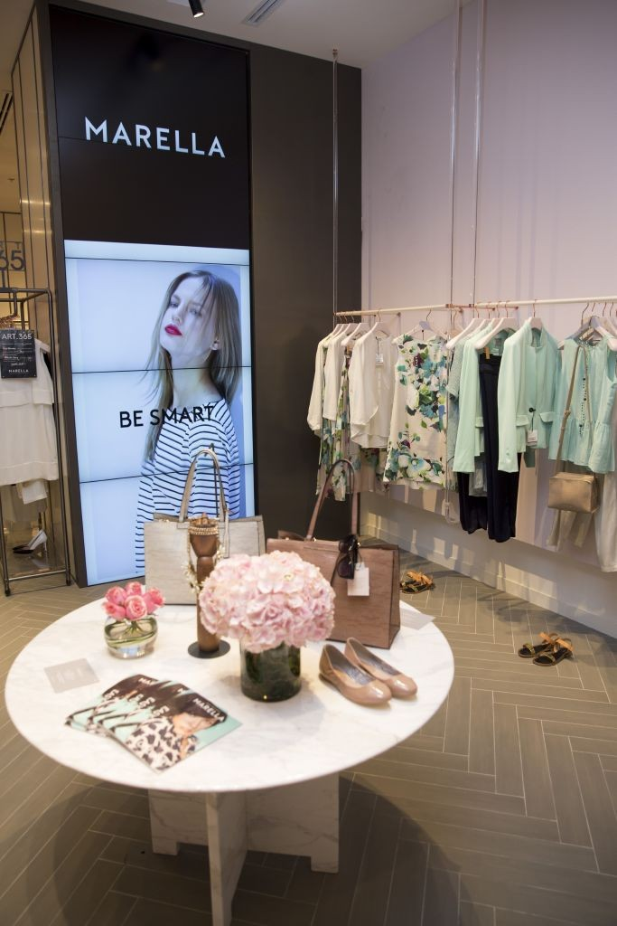 resized_Marella in-store with screen