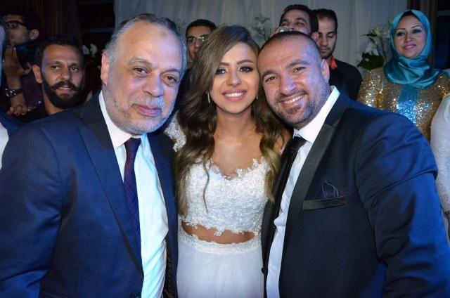 العروسان والدكتور أشرف زكي