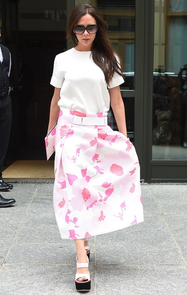 Victoria Beckham is looking stylish in her summer fashion leaving her hotel