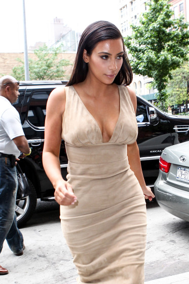 A sweaty Kim Kardashian arrives back at her hotel after filming