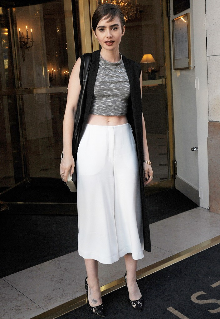 Lily Collins bares her midriff while exiting the Bristol Hotel **USA ONLY**