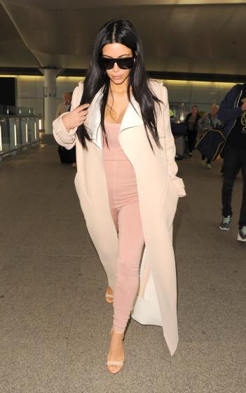 A pregnant Kim Kardashian's maternity style is on point at Heathrow **NO UK**