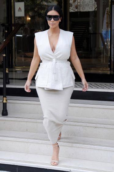 Kim Kardashian looks stunning in white as she starts her morning in Paris - Part 2 **USA ONLY**