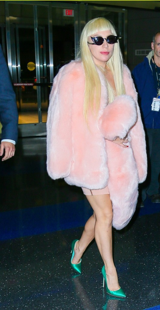 Lady Gaga Jets Out of New York Wearing a Baby Pink Fur Coat & Emerald Green Heels