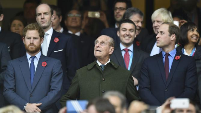 Britain's Prince Harry, Prince Philip and Prince William attend the Rugby World Cup final match between New Zealand against Australia at Twickenham in London