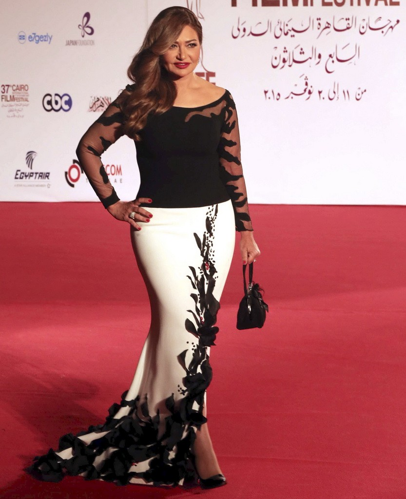 Egyptian actress Laila Alwy poses at the opening ceremony of the 37th Cairo International Film Festival in Cairo