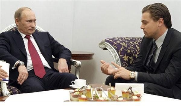 ليوناردو ديكابريو مع الرئيس الروسي فلاديمير بوتين