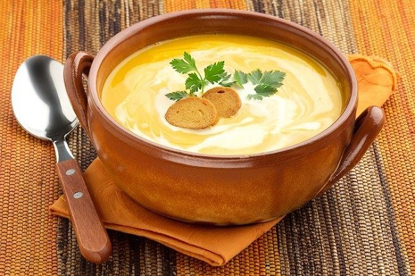 creamy carrot soup with croutons and parsley