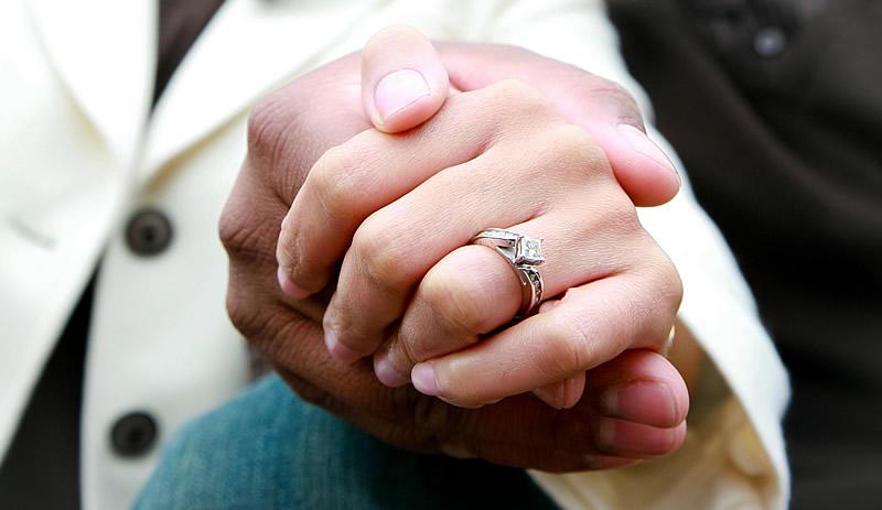 woman-wearing-a-diamond-engagement-ring