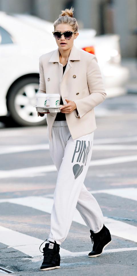 Gigi Hadid seen wearing white blazer and sweatpants while making a coffee run in NYC