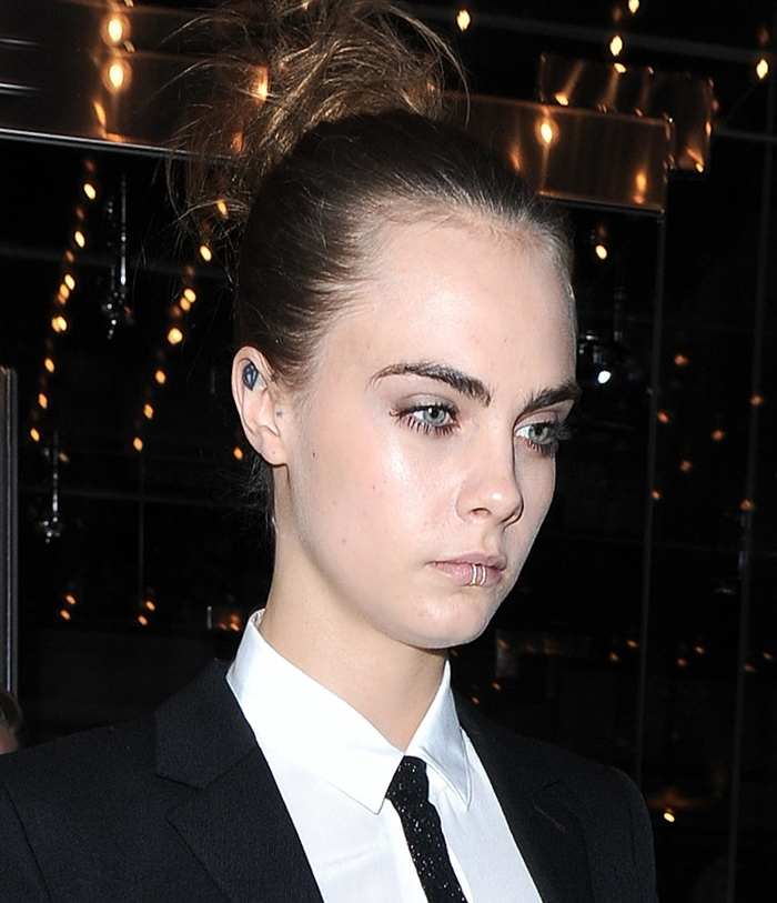 Cara Delevingne leaving her hotel wearing a rather eye catching lip ring