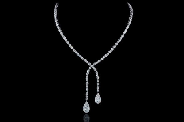 Forevermark Crossover necklace featuring pear- and oval-shaped diamonds totaling 23.62 carats set in