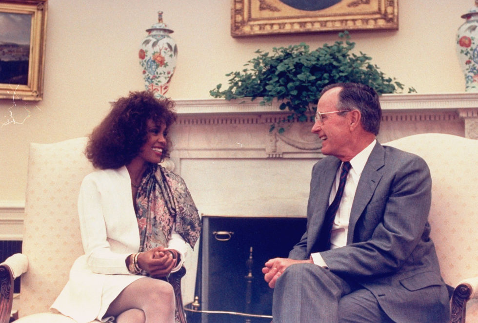 George H.W. Bush and Whitney Houston ​