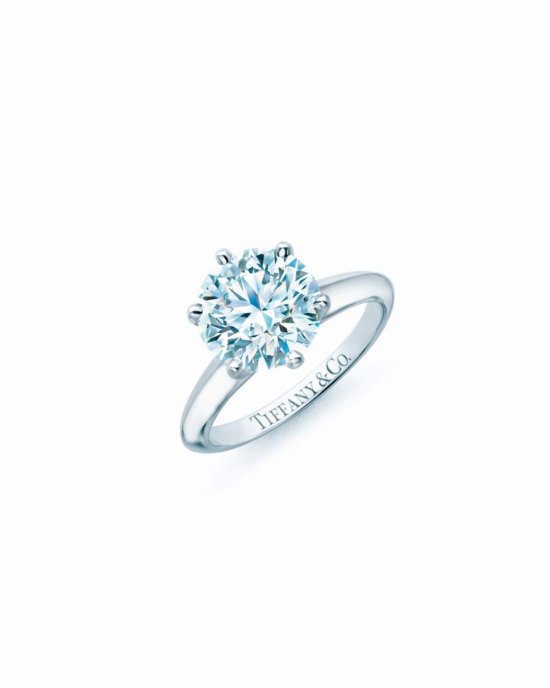 resized_The Tiffany® Setting, a design classic that holds the diamond away from the band on six prongs, permitting a more complete return of light through the diamond