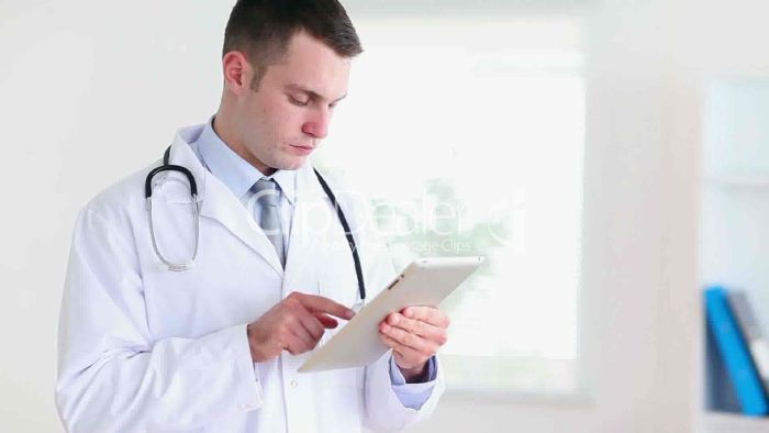 resized_12-1873978-Young-doctor-using-a-tablet-computer