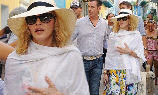 Singer Madonna walks along a street in H