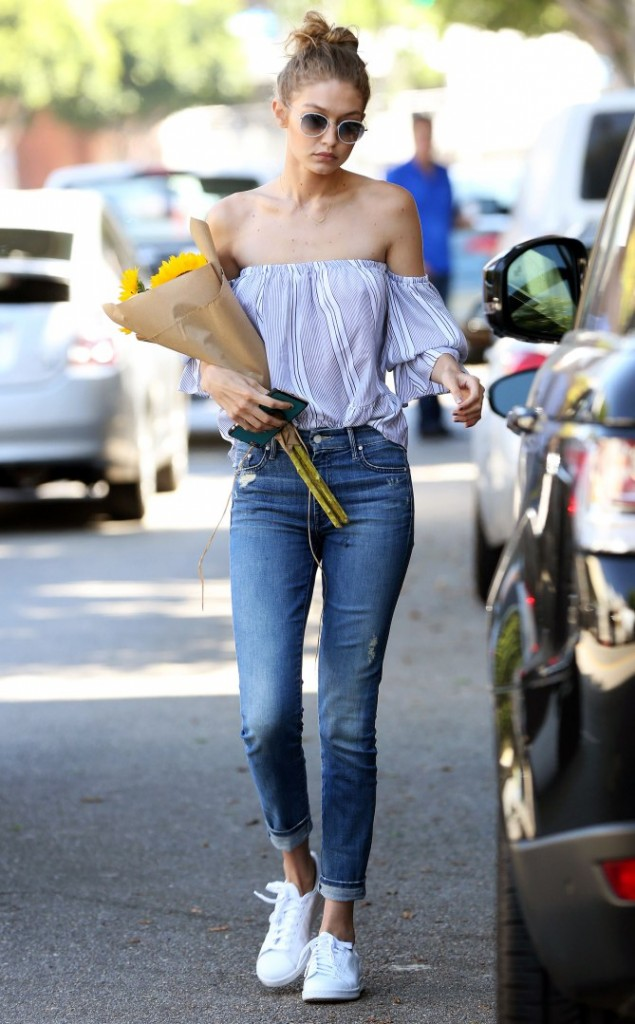 *EXCLUSIVE* Gigi Hadid has a hand full of flowers and a heart full of generosity