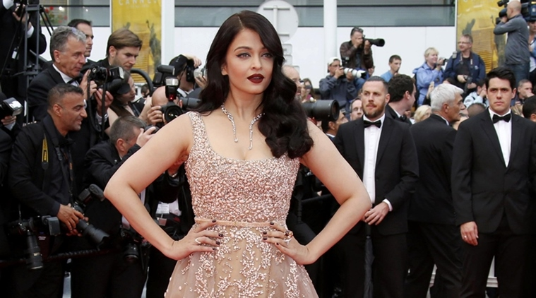 Actress Aishwarya Rai  poses on red carpet as she arrives for the screening of the film