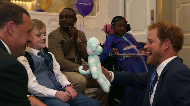 Harry chats to Inspirational Child Award Winner Samuel Merrick (second left), and his father Paul