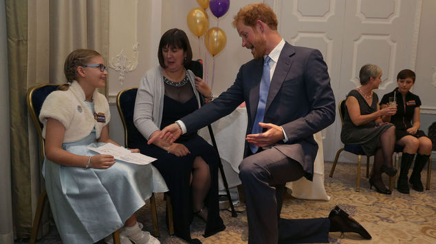 Prince Harry with Good Morning Britain Inspirational Young Hero Award Winner Jessica Davis and her mother Paula