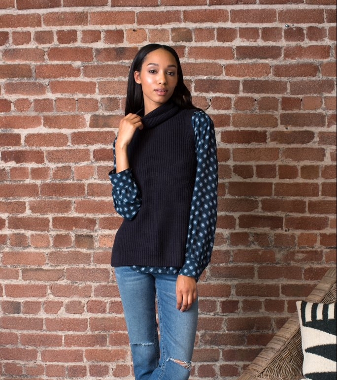 layer-sleeveless-sweater-over-blouse