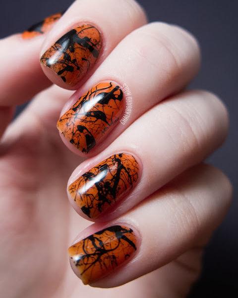 gallery-1441207555-orange-and-black-splatter-nails