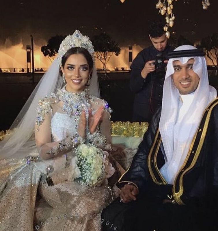 بلقيس وزوجها مع حفل الزفاف