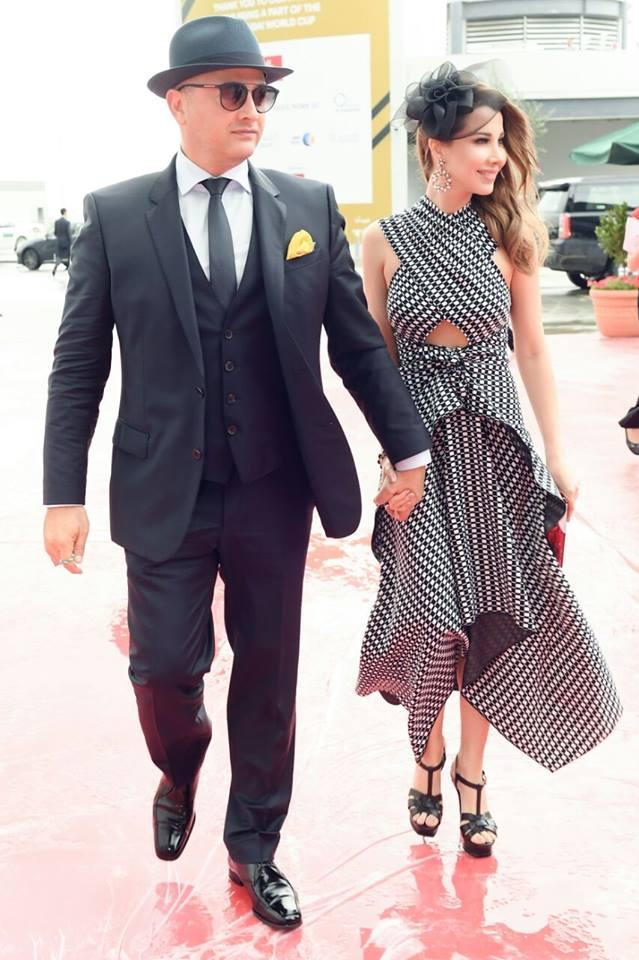 أناقة نانسي عجرم وزوجها في كأس دبي العالمي للخيول