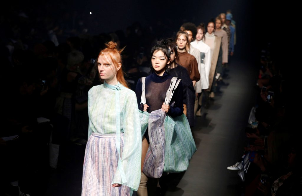 Models present creations by designers Iwata and Takizawa from their Autumn/Winter 2018 collection for their brand