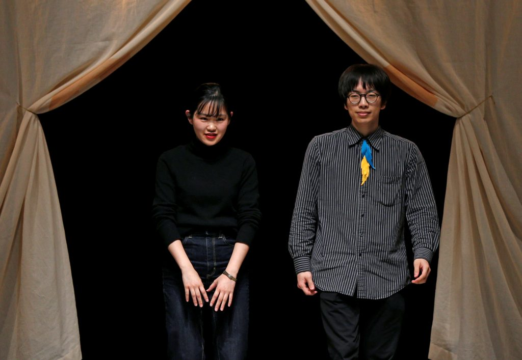 Designers Fujita and Miyazaki acknowledge the audience after their Autumn/Winter 2018 collection for their brand