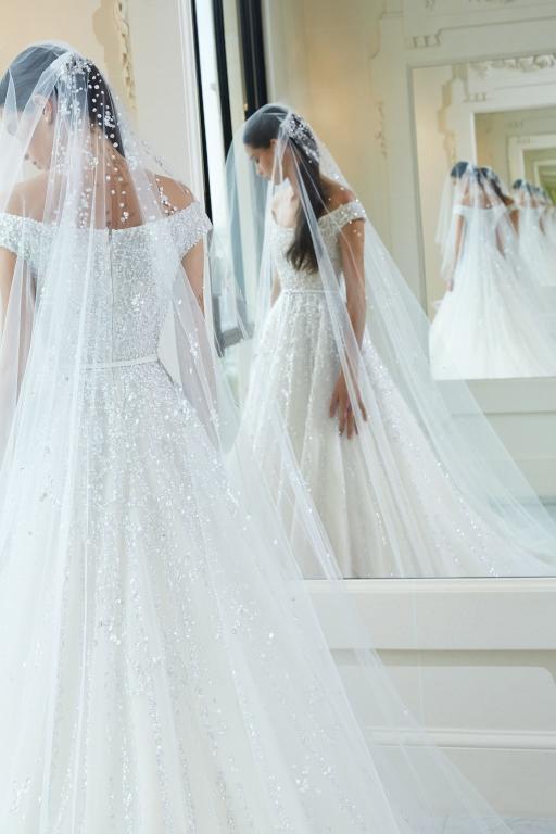 فستان-زفاف-بالطرحة-الطويلة
