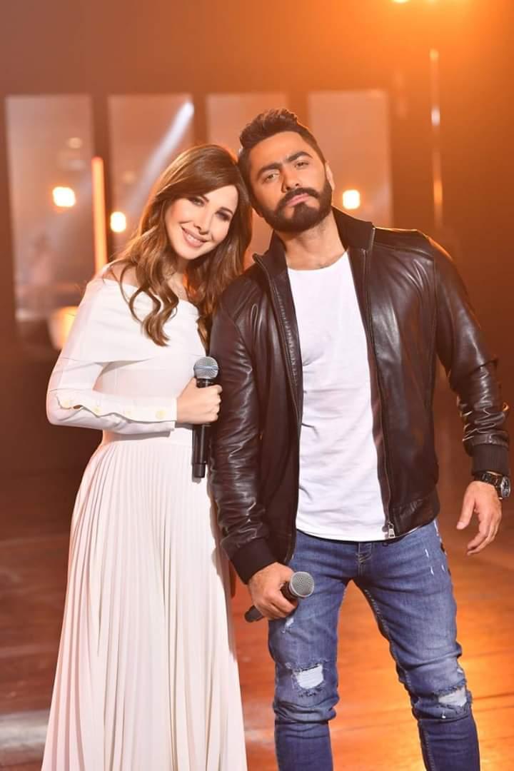 النجم تامر حسني مع النجمة نانسي عجرم في أحد الحملات الإعلانية