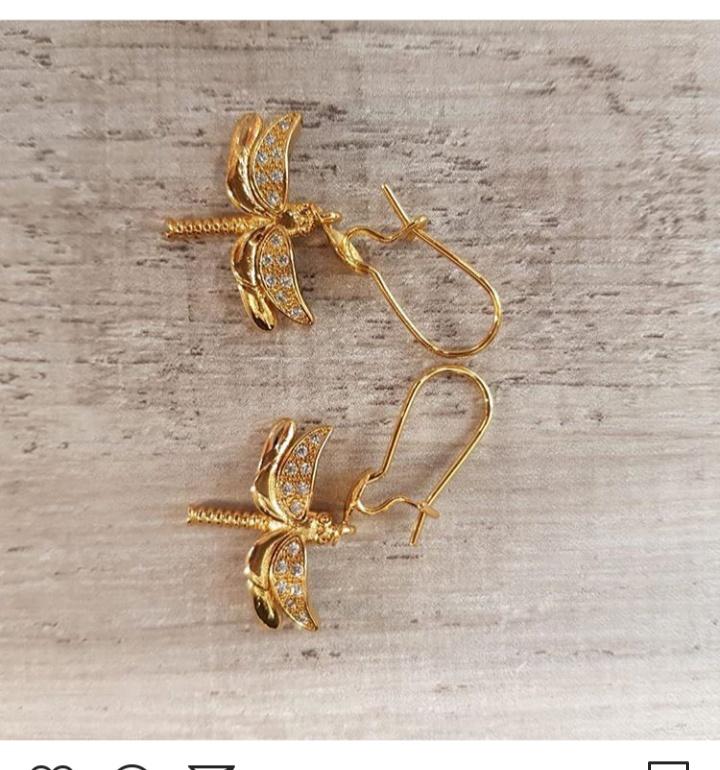 صورة حلق ذهب طويل من مجوهرات تراجي