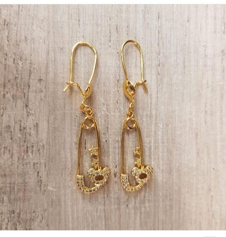 تصميم حلق ذهب طويل من مجوهرات تراجي