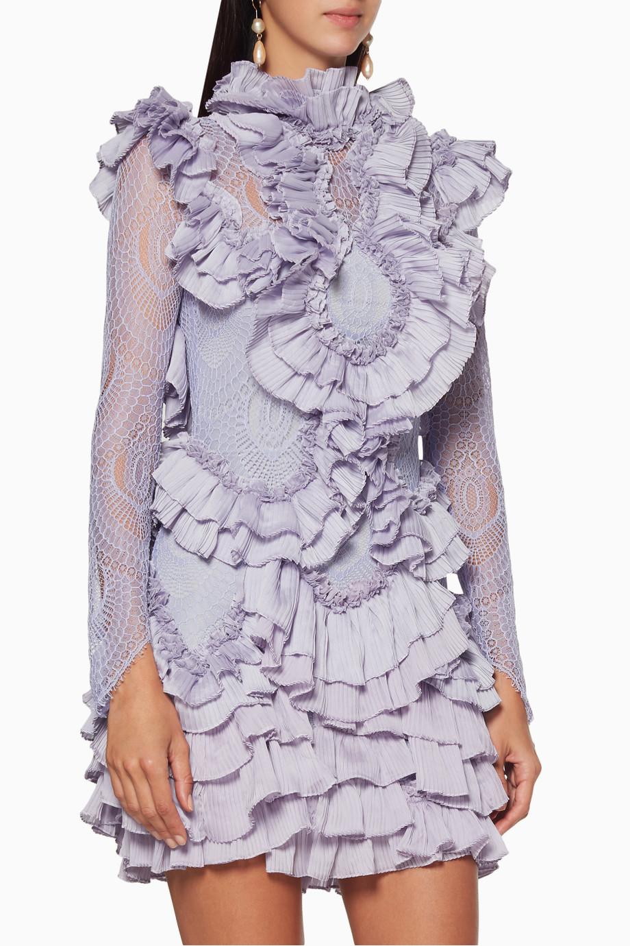 تصميم مميز لفستان كشكش قصير باللون الارجواني الفاتح