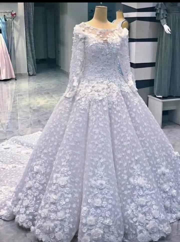 صور فساتين زفاف باللون الشامبين ملائمة للمحجبات