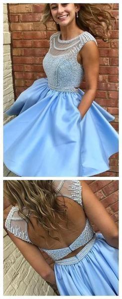 صورة فستان ستان قصير منفوش باللون الأزرق السماوي