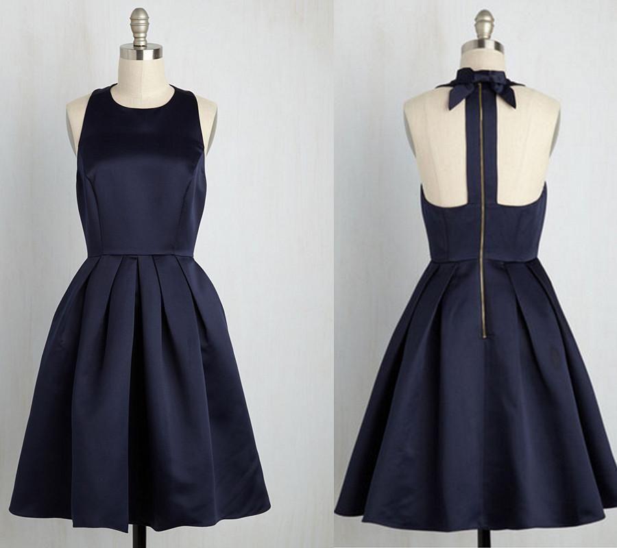 تصميم فستان ستان قصير منفوش باللون الأسود