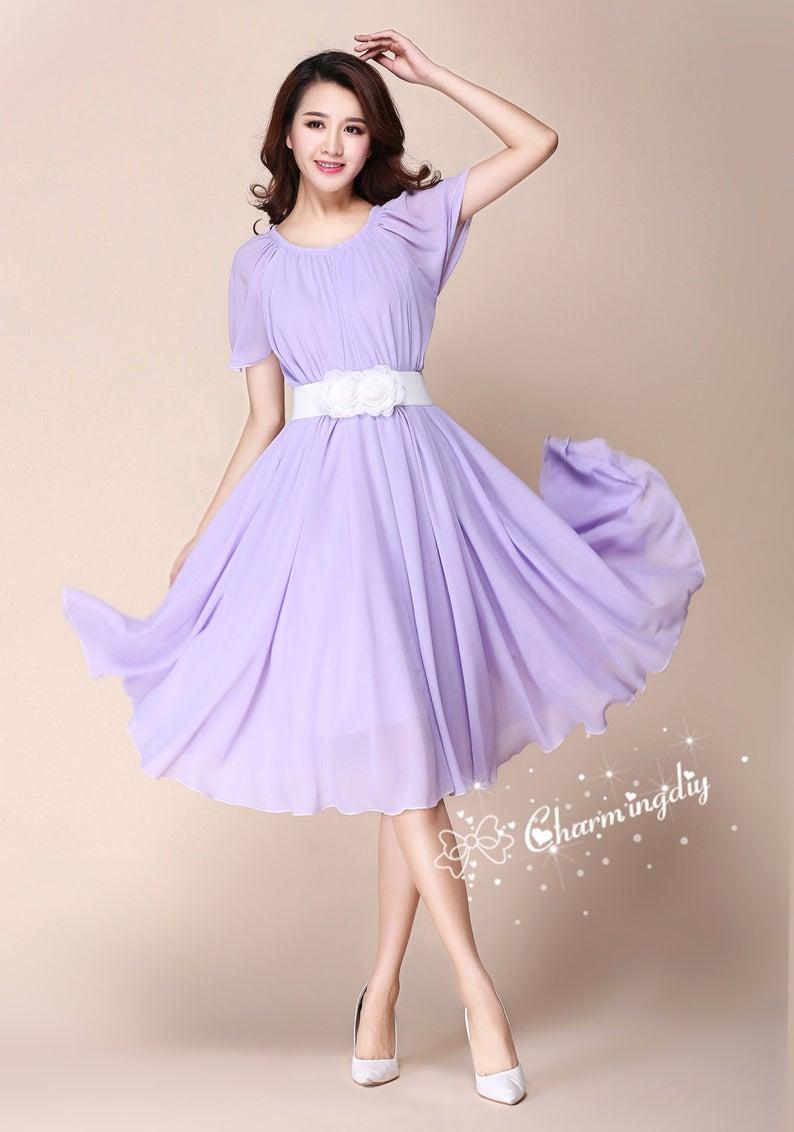 صور تصميم فستان خطوبة قصير باللون البنفسجي